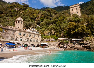 SAN FRUTTUOSO, ITALY - MAY 13, 2013 The  breathtaking bay of San Fruttuoso near Genoa with the old abbey from 10th century is accessible only by a pedestrian path on the hill behind or by the sea