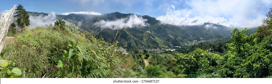 San Gerardo de Rivas, Costa Rica. Beautiful view of the cloud forest from the mountains. Green hills and white clouds.