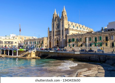 San Giljan, Malta, on January 5, 2019. A facade of Parish Church of Our Lady of Mount Carmel on the bank of Balluta bay