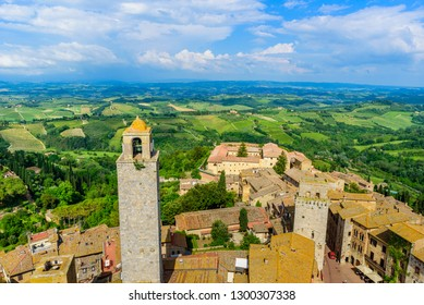 San Gimignano - Aerial view of the historic town with beautiful landscape scenery on a sunny summer day in Tuscany, small walled medieval hill town with towers in the province of Siena, Italy