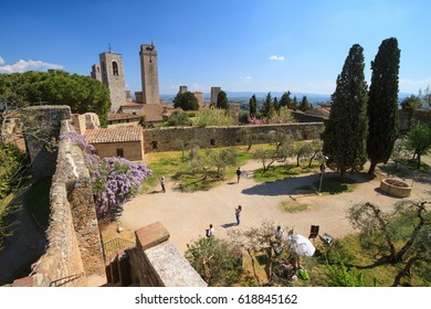 San Gimignano, April 2017:  View of medieval fortress famous as the Town of Fine Towers , on April 2017 in San Gimignano, Siena, Tuscany, Italy