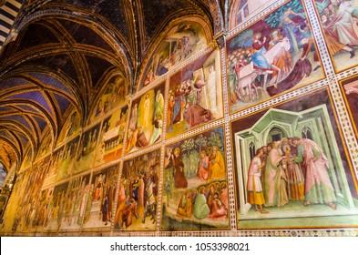 San Gimignano, Italy - 07 31 2017: Interior of the Collegiate Church of Santa Maria Assunta
