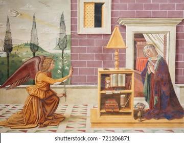 SAN GIMIGNANO, ITALY - JULY 11, 2017: Fresco depicting The Annunciation, created by Sebastiano Mainardi in 1482, in the Collegiata of San Gimignano, Italy.