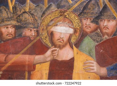 SAN GIMIGNANO, ITALY - JULY 11, 2017: Renaissance Fresco depicting Jesus, blindfolded, on Good Friday, in the Collegiata of San Gimignano, Italy.
