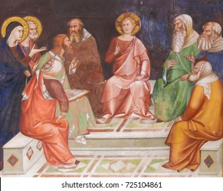 SAN GIMIGNANO, ITALY - JULY 11, 2017: Renaissance Fresco depicting Jesus Christ, as a boy among the Doctors in the Temple of Jerusalem, in the Collegiata of San Gimignano, Italy.