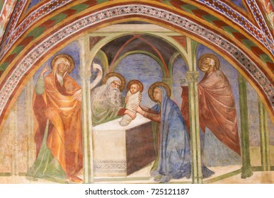 SAN GIMIGNANO, ITALY - JULY 11, 2017: Fresco depicting the Presentation at the Temple in the Collegiata or Collegiate Church of San Gimignano, Italy.