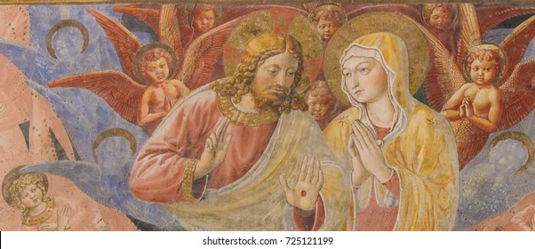 SAN GIMIGNANO, ITALY - JULY 11, 2017: Renaissance Fresco depicting Jesus and Mother Mary in the Collegiata or Collegiate Church of San Gimignano, Italy.
