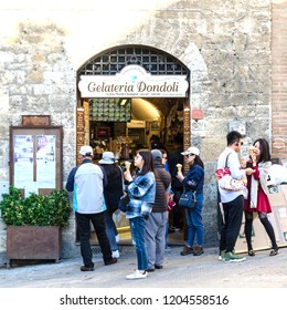 San Gimignano, Italy - October 3, 2018: The famous ice cream, gelato, shop in the village San Gimignano in Tuscany, Italy