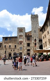 SAN GIMIGNANO - JULY 16: Tourists visitng historic centre on July 16, 2011 in San Gimignano, Italy. The Historic Centre of San Gimignano is a UNESCO World Heritage Site