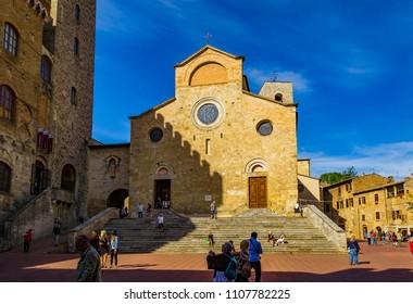 SAN GIMIGNANO, SIENA, ITALY - September 27, 2015: View from Piazza del Duomo of the Basilica della  collegiata of Santa Maria Assunta, also called Duomo.