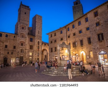 San Gimignano / Tuscany / Italy / 08-20-2018 - Piazza della Cisterna in the historic city of San Gimignano on a summer evening.