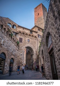 San Gimignano / Tuscany / Italy / 08-20-2018 - Tourists visiting the famous Tuscan medieval town.