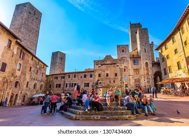 San Gimignano, Tuscany, Italy - October 25, 2018: Old medeival square and towers in typical Tuscan medieval town, popular tourist destination