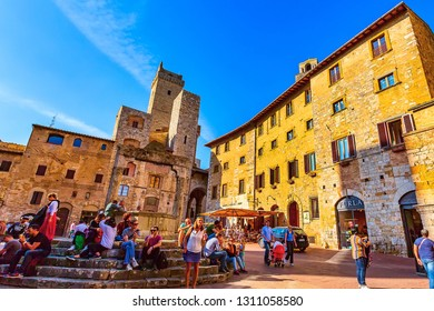 San Gimignano, Tuscany, Italy - October 25, 2018: Old medeival square and towers in typical Tuscan town, popular tourist destination