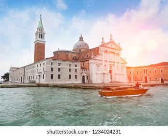 San Giorgio Maggiore church view. Taxi Boat on canal. Venice. Italy