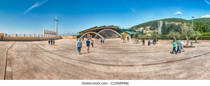 SAN GIOVANNI ROTONDO, ITALY - JUNE 10: Panoramic view with facade of the Sanctuary of Saint Pio of Pietrelcina, Catholic shrine designed by Renzo Piano in San Giovanni Rotondo, Italy, June 10, 2018