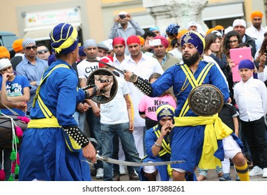 SAN GIOVANNI VALDARNO, ITALY - APRIL 15, 2014: Nagarkirtan, Indian religious procession. All participants wear traditional dress and turban with the emblem of the Sikh faith.