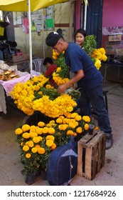San Gregorio Atlapulco, Mexico/Mexico--October 31, 2018. Street vendors selling cempasuchil (marigolds), Day of the Dead flowers (Flor de Muerto).