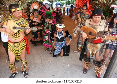 San Gregorio Atlapulco, Mexico/Mexico--September 2, 2018. Musicians and healers accompany a young Aztec woman walking on her knees during an initiation ceremony.