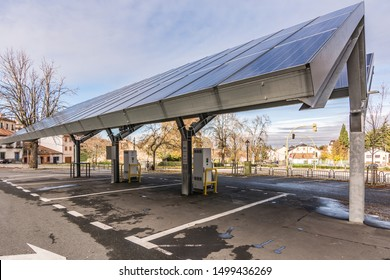 SAN ILDEFONSO, SEGOVIA, SPAIN - SEPTEMBER 24, 2017: Car charging station for self-sufficient and first photovoltaic panels in Europe. it is also free.