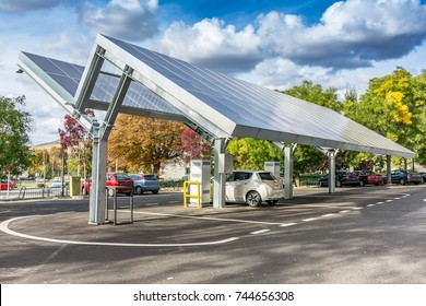 SAN ILDEFONSO, SEGOVIA, SPAIN - SEPTEMBER 24, 2017: Nissan Leaf charging station for self-sufficient and first photovoltaic panels in Europe. it is also free.