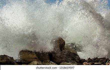 SAN JACINTO, MANABI ECUADOR February 10 2016, High tides, combined with rising sea levels create crashing wave on the coast of Ecuador