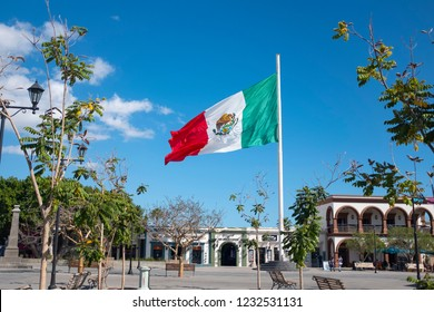 San Jose, Baja / Mexico 11-13-2018 A large flag is flown in the town center of San Jose de Los Cabos Mexico the sister city to the popular Cabo San Lucas on the Baja peninsula of Mexico.