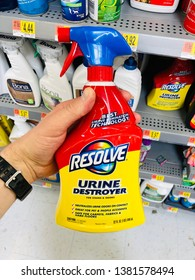 San Jose, CA - April 24, 2019: Man holding a spray bottle of RESOLVE Urine Destroyer inside a supercenter Wal-Mart store.