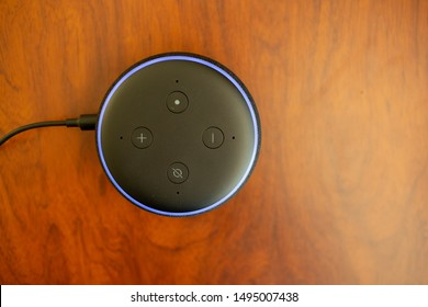 San Jose, CA - August 4, 2019: Plugged in Echo Dot by Amazon, company's smallest and inexpensive voice assistant.