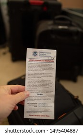 San Jose, CA - August 4, 2019: TSA notice of baggage inspection tag, holding above backpack.