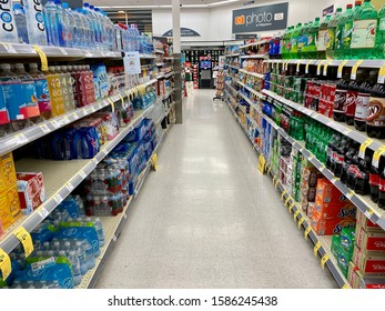 San Jose, CA - December 10, 2019: Wide view of Walgreens store isles shelves filled with bottles water and soda in plastic bottles.