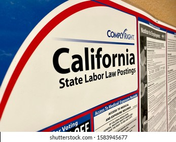 San Jose, CA - December 4, 2019: California State Labor Law Postings banner inside a break room. ComplyRight branded.