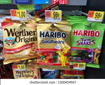 San Jose, CA - February 21, 2019: Gummy bears, worms by Haribo and caramel hard candies displayed on a rack in the check out register at Wal Mart store.