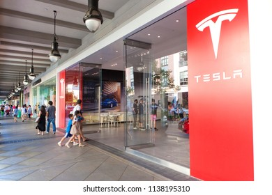 San Jose, CA - July 2, 2016: Customers walk into a Tesla showroom at the Santana Row shopping center in San Jose, CA.