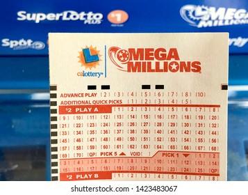 San Jose, CA - June 13, 2019: Mega Millions Lottery ticker for custom quick picks.