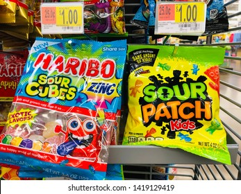 San Jose, CA - June 7, 2019: Haribo Sour Cubes and Sour Patch Kids candies in bags for sale at $1 each in a check out lane at a Wal-Mart store.
