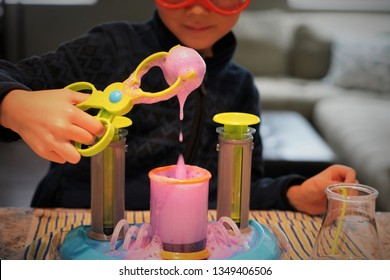"""San Jose, CA - March 24, 2019. Child playing with a """"Beaker Creatures"""" Science Kit called """"Liquid Reactor Super Lab."""" A popular educational toy for kids ages 5 and older."""