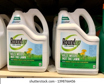 San Jose, CA - May 15, 2019: Gallon containers of RoundUp for Lawns on store shelves. Manufactured by Monsanto Corporation.