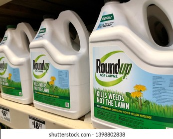 San Jose, CA - May 15, 2019: Closeup of RoundUp Weed Killer spray chemical containers on the store shelf. Manufactured by Monsanto Corporation.
