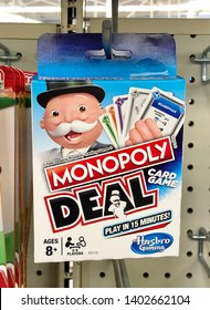 San Jose, CA - May 19, 2019: Monopoly Deal Card Game by Hasbro Gaming, new box hanging on a rack inside a toy store.