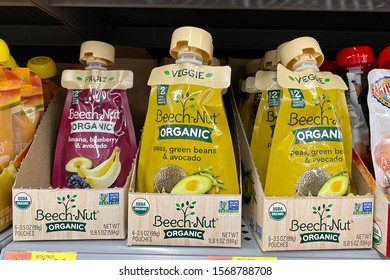 San Jose, CA - November 23, 2019: Pouches of Beech-Nut organic veggie baby food in boxes. Non GMO verified.