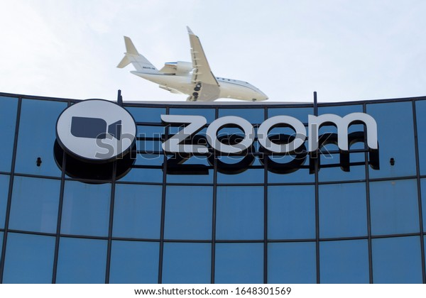 San Jose, CA, USA - Feb 17, 2020: A plane flying over Zoom Video Communications Headquarters in downtown San Jose. Zoom, the video conferencing platform, is facing criticism due to security issues.