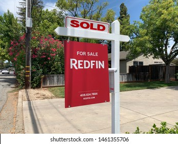 San Jose, CA (USA) - July 25, 2019. A sale pending real estate sign by Redfin, one of America's top real estate companies that help sell and buy homes.