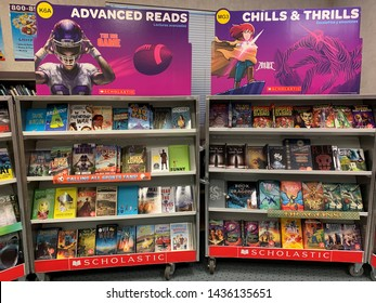 San Jose, CA (USA) - March 21, 2019. A Scholastic Book Fair displaying a variety of books for sale at a local Elementary school in San Jose, California.