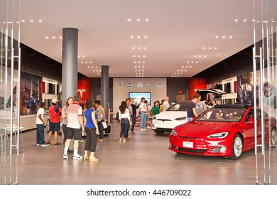 SAN JOSE, CALIFORNIA - JULY 2, 2016: Guests to a Telsa Motors store engage with company staff and view showroom cars on July 2, 2016 in San Jose, California.