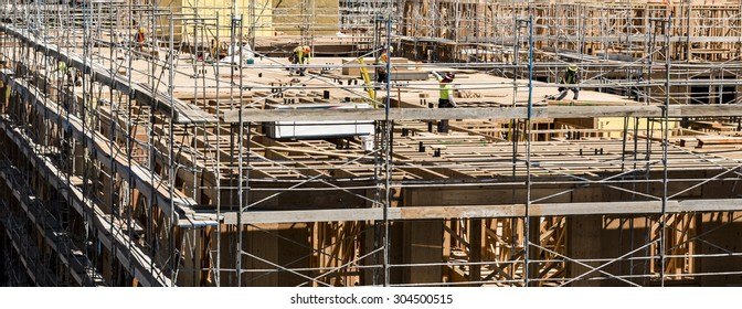 SAN JOSE, CALIFORNIA, UNITED STATES  August 8, 2015: Construction workers on a high-rise building construction site.