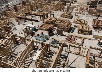 SAN JOSE, CALIFORNIA, UNITED STATES, August 12, 2015: An aerial view of a large construction site, including wall framing atop a concrete slab foundation.