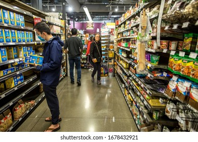 San Jose, California / USA - 03/20/2020: People shopping at grocery store with the mask in the coronavirus pandemic