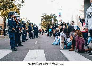 San Jose, California, USA, May 31, 2020, Protest after George Floyd death, Black Lives Matter group standing against police, people kneel