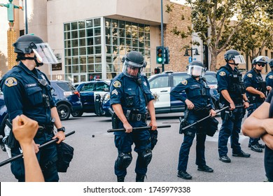 San Jose, California, USA, May 31, 2020, Protest after George Floyd death, police cops and national guards standing against protesters